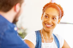 Portrait of smiling afro-american office worker sitting in offfice Royalty Free Stock Photography