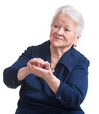 Portrait of smiling applauding old woman Stock Photography