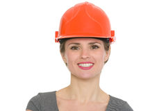 Portrait of smiling architect woman in helmet Stock Photos