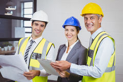 Portrait of smiling architects. Standing in building Stock Photography