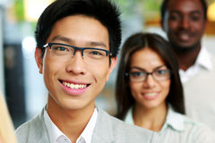 Portrait of a smiling asian businessman standing Stock Photos