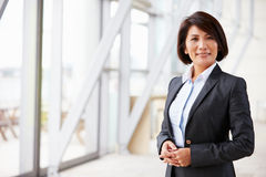 Portrait of smiling Asian businesswoman, standing Stock Photography
