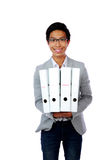 Portrait of a smiling asian man with folders Stock Photography