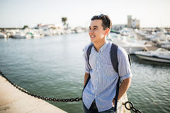 Portrait of smiling asian man near sea boats in the old european city. Tourist. Portrait of smiling asian man near sea boats in the old european city Stock Photography