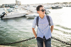 Portrait of smiling asian man near sea boats in the old european city. Tourist. Portrait of smiling asian man near sea boats in the old european city Royalty Free Stock Photos