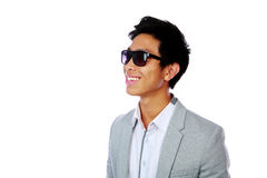 Portrait of a smiling asian man in sunglasses Royalty Free Stock Images
