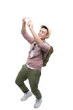 Portrait of smiling asian man taking selfie on white background stock images