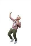 Portrait of smiling asian man taking selfie on white background Royalty Free Stock Photo