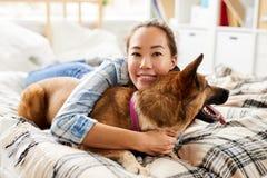 Asian Woman Hugging Dog stock images