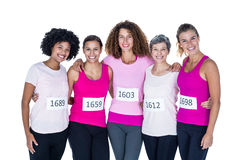 Portrait of smiling athletes with arms around Royalty Free Stock Photos
