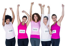 Portrait of smiling athletes with arms raised Stock Photo