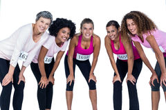 Portrait of smiling athletes bending Royalty Free Stock Images