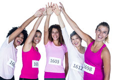 Portrait of smiling athletes putting their hands together with arms raised Royalty Free Stock Photography