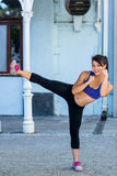 Portrait of smiling athletic woman doing martial arts Royalty Free Stock Photos