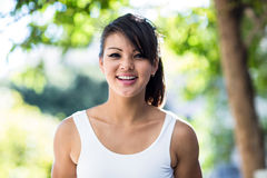 Portrait of smiling athletic woman looking at camera Royalty Free Stock Image