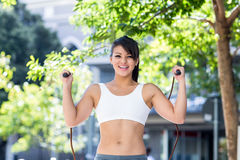 Portrait of smiling athletic woman skipping Royalty Free Stock Image