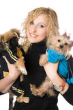 Portrait of smiling attractive blonde with two dogs. Isolated Royalty Free Stock Images