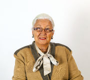 Portrait of smiling attractive senior woman. In front of a white background Royalty Free Stock Image