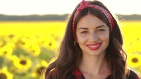 Portrait of smiling attractive woman in nature stock video footage