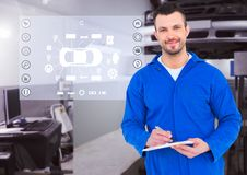 Portrait of a smiling automobile mechanic holding clipboard Stock Images