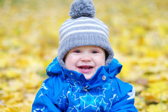 Portrait of smiling baby age of 1 year outdoors in autumn Royalty Free Stock Photo