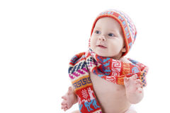 Portrait of smiling baby in knitted hat and scarf Stock Photo