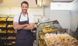 Portrait of a smiling baker with arm crossed Royalty Free Stock Image