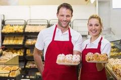 Portrait of smiling bakers having a pastry Royalty Free Stock Image
