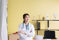 Portrait of smiling beautiful asian woman doctor standing and cross arms looking something at hospital,Happy and positive thinking stock photos