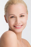 Portrait of smiling beautiful blond, isolated on white Royalty Free Stock Photo