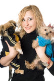 Portrait of smiling beautiful blonde with two dogs. Isolated Royalty Free Stock Photography