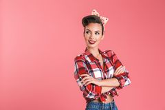 Portrait of a smiling beautiful brunette pin-up woman Royalty Free Stock Image