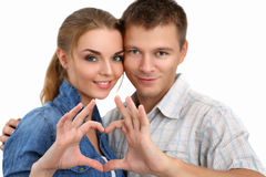 Portrait of smiling beautiful girl and her boyfriend making shap Stock Images