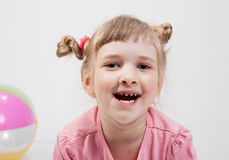 Portrait of a smiling beautiful girl. On white background Stock Photo