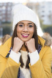 Portrait of smiling beautiful latin woman with winter clothing. royalty free stock photos