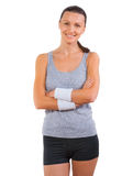 Portrait of smiling beautiful sports woman with crossed arms iso Stock Image