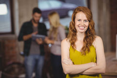 Portrait of smiling beautiful woman with arms crossed Stock Image