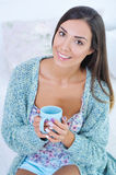 Portrait of a smiling beautiful woman with morning coffee Royalty Free Stock Images