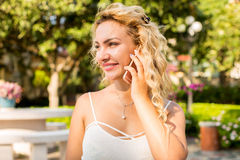 Portrait Of A Smiling Beautiful Woman Talking On The Phone Stock Photography