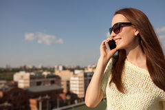 Portrait Of A Smiling Beautiful Woman Talking On The Phone Royalty Free Stock Photography