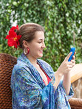 Portrait of smiling beautiful woman texting with her phone. Royalty Free Stock Photos