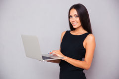 Portrait of a smiling beautiful woman using laptop Stock Photo