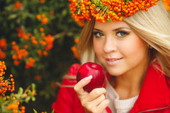 Portrait of smiling beautiful woman wreath of berries in autumn colors Stock Images