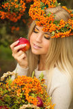 Portrait of smiling beautiful woman wreath of berries in autumn colors