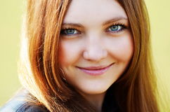 Portrait of smiling beautiful young woman close-up,. Portrait of a happy woman smiling outdoors. close-up Stock Images