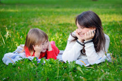 Portrait of smiling beautiful young woman and little daughter Stock Photography