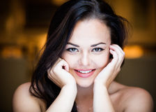 Portrait of a smiling beautiful young woman Stock Images