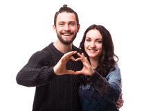 Portrait of smiling beauty girl and her handsome boyfriend making shape of heart by their hands. Stock Photo