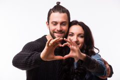 Portrait of smiling beauty girl and her handsome boyfriend making shape of heart by their hands. Royalty Free Stock Image