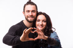Portrait of smiling beauty girl and her handsome boyfriend making shape of heart by their hands. Royalty Free Stock Images